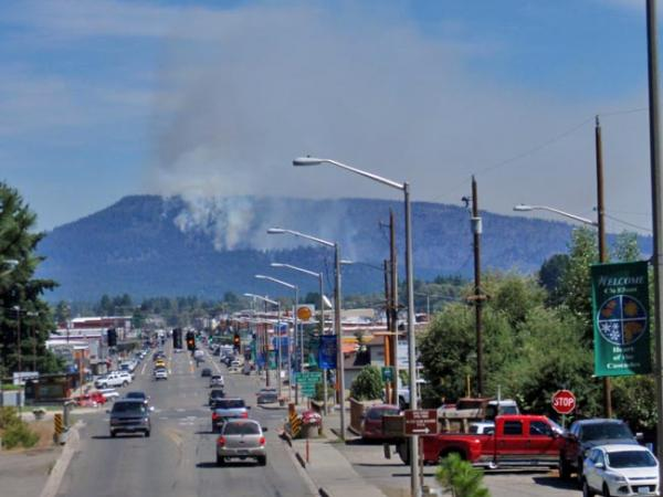 Smoke from the fire has led officials to warn people who have difficulty breathing to stay inside. Photo by Tom Banse