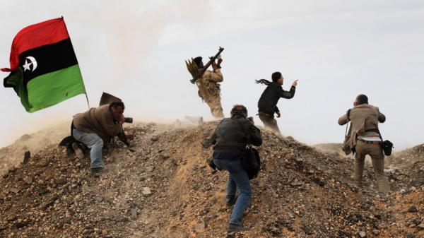 Photojournalists, including <em>New York Times</em> staff photographer Tyler Hicks, photograph Libyan rebels on March 10 in Ras Lanuf, Libya. Hicks and three other <em>Times</em> journalists — Stephen Farrell, Lynsey Addario and Anthony Shadid — were released March 21 after being held captive by Libyan forces.