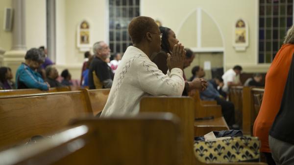 A parishioner prays during the healing mass.
