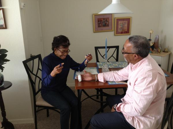 Ernestine Marshall learns more about the PED emergency device she wears as part of the monitoring pilot.