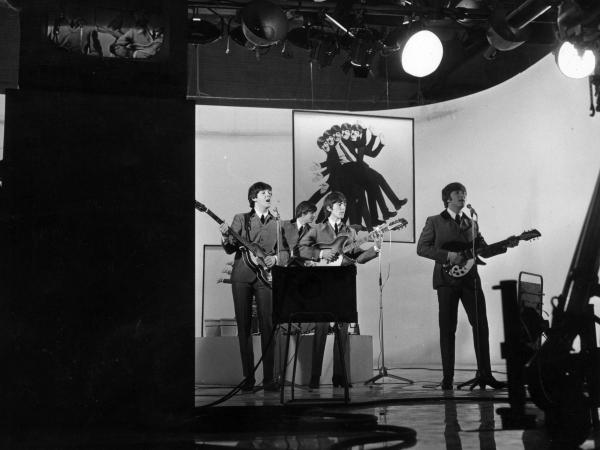 The Beatles perform one of their songs while filming <em>A Hard Day's Night</em> in 1964.