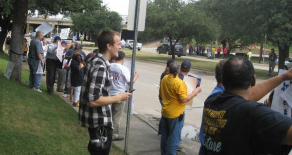 Protesters outside the Dallas Anatole opposing the meeting of the American Legislative Exchange Council.