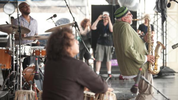 Sangam performs at the 2011 Newport Jazz Festival. From left to right: Eric Harland, Zakir Hussain and Charles Lloyd.