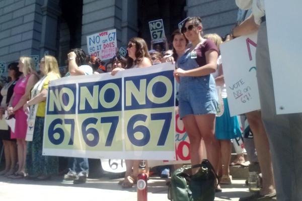 Opponents of Amendment 67 hold a rally at the state capitol in Denver. The amendment would give unborn babies the same constitutional and legal rights as a person.