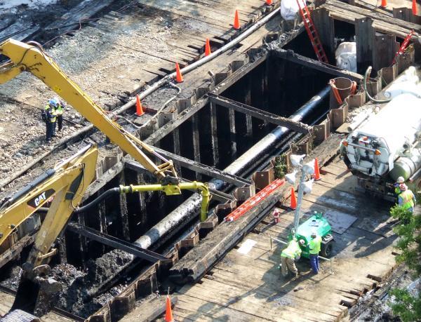 In August of 2010, crews prepare to remove the broken section of Enbridge's Line 6B pipeline.