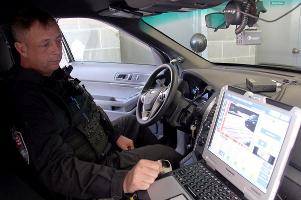 Winooski Sergeant Michael Cram operates an automatic license plate reader (ALPR) in his cruiser on Sept. 20. ALPRs use high-speed cameras mounted on police cruisers that take photos of passing cars. There are 116 in the state.