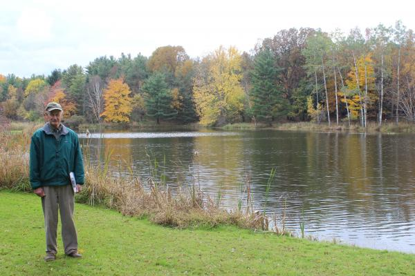 Peter Baldwin by the pond on his property. Baldwin owns 225 acres of woodland. It's designated as a conservation area.