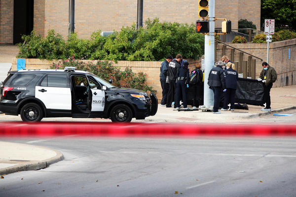 The scene outside APD headquarters on Friday November 28, 2014 following a shooting by Larry McQuilliams.
