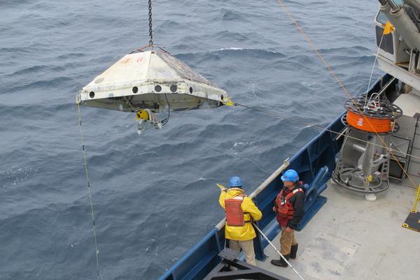 Researchers retrieve an ocean-bottom seismometer off the coast of Oregon in 2013.