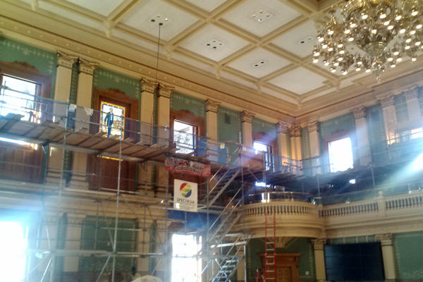 The restoration work in the House chamber undercovered stenciling and a green color.