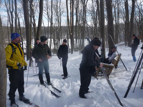 Snack stop on a glacial overlook while skiing the scenic but challenging Potawatomi mountain-biking trail in Pinckney.