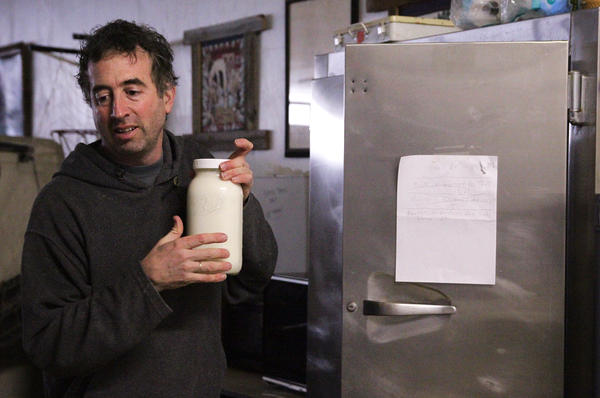Joel Gruver is the milkman for a group of raw milk drinkers in Macomb, Ill.