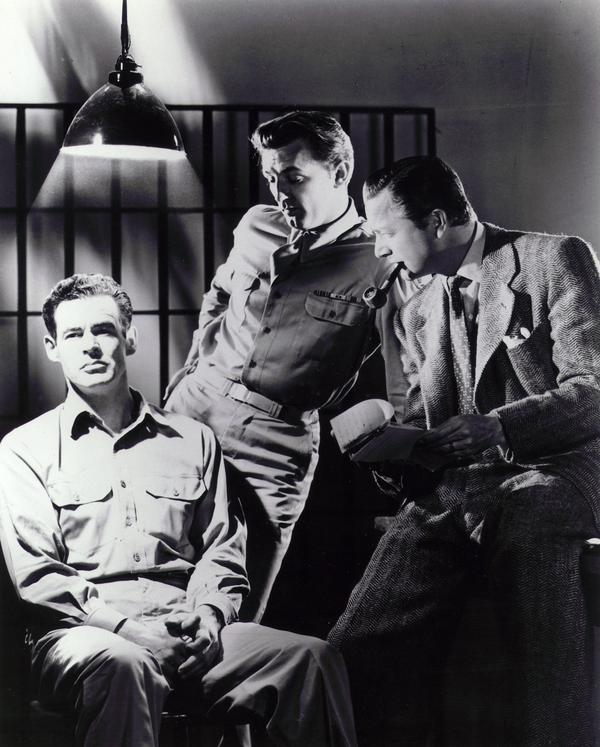 A lot of what we think we know about interrogation tactics comes from television and movies. Above (from left), Robert Ryan, Robert Mitchum and Robert Young appear in a scene from the 1947 film <em>Crossfire.</em>