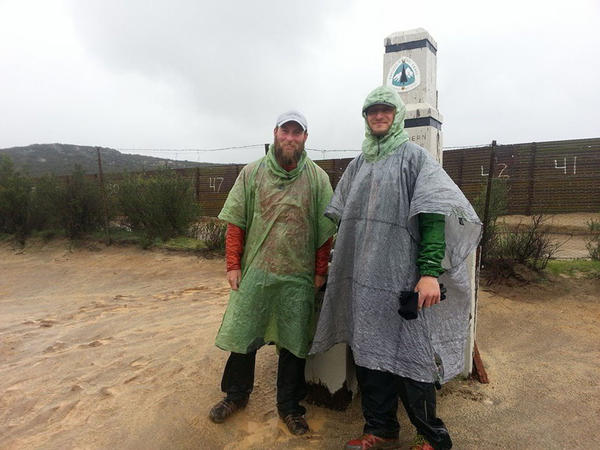 Shawn Forry (left) and Justin Lichter arrived at the southern end of the Pacific Crest Trail on Sunday. The rain reminded them of the trek's first day at the Canadian border last October.