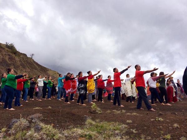 Native Hawaiians dance in honor of Mauna Kea at the base of Pu'u Huluhulu on the Big Island.