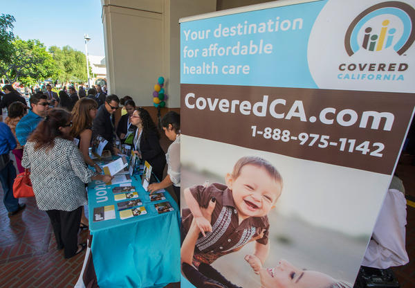 "At sign-up events like this one in Los Angeles in 2013, Covered California pledged ""affordability"" in health insurance as one of its main selling points."