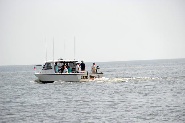 A fishing boat full of reporters.