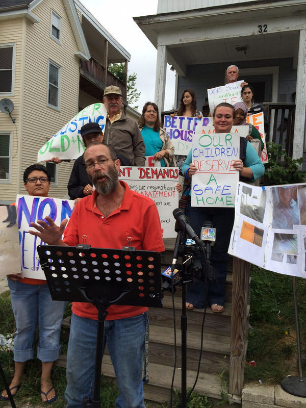 Lewiston tenant Shawn Greeley protests his living conditions outside his apartment building Tuesday.