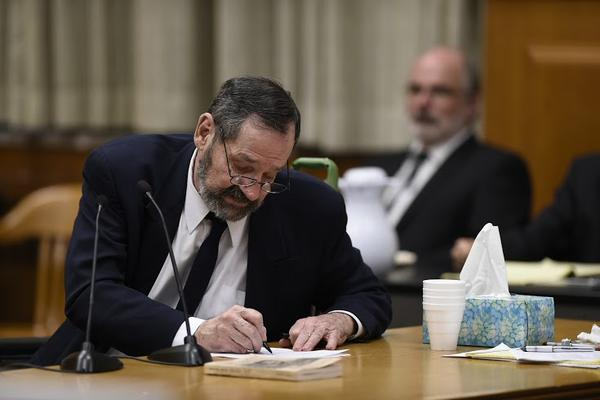 Frazier Glenn Cross Jr., who has been charged with the shooting deaths of three people at the Jewish Community Center in Overland Park, edits his remarks during the opening of his trial. Cross' capital murder trial began Monday morning.