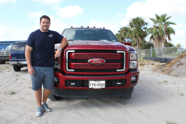 Ryan Peck repossesses vehicles in Corpus Christi, Texas. His business is seeing the upside of the downturn in oil prices: a spike in the number of expensive trucks bought by oilfield workers during an earlier boom.