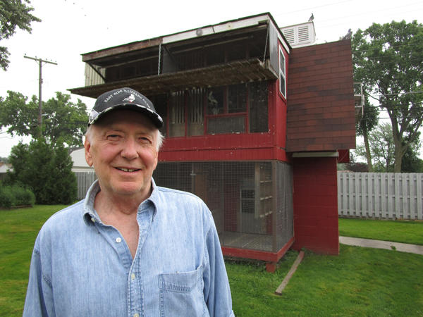 Larry Fatalski in front of his backyard coop in St. Clair Shores.