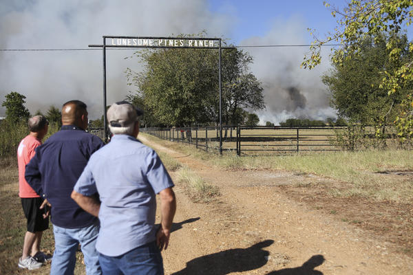Bastrop County officials watch as the Hidden Pines fire burns near SH71 and Kellar Road late Wednesday afternoon.