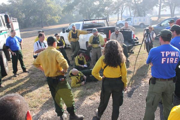 Fire crews in Bastrop County get their daily briefing Thursday morning.