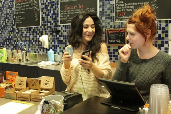 Baristas Sarah Castro (left) and Caitlyn Feeney take coffee orders at Cappy's.