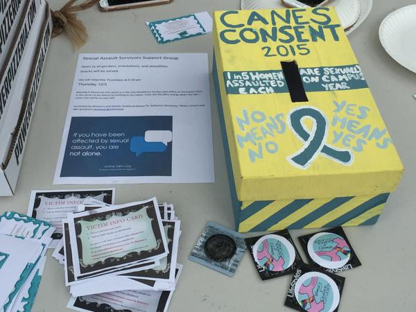 Small flyers with sexual assault statistics to condoms with messages promoting the Womens and Genders studies are offered to anyone who stops by.