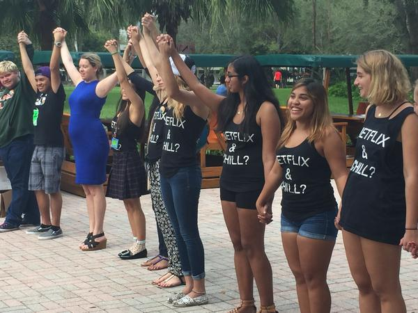 Dr. Katherine Westaway leads her students in one final moment of solidarity against sexual assault on campus at the end of Canes Consent.