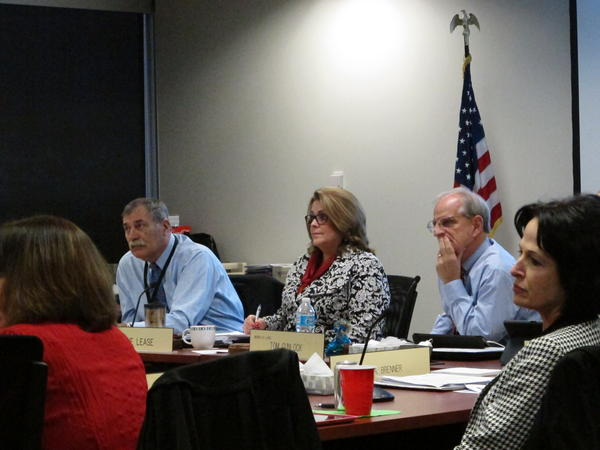 Ohio Department of Education Superintendent Richard Ross (left) sits in on a State Board of Education meeting. Ross attended a couple of contentious meetings in 2015 in the aftermath of the data scrubbing scandal.