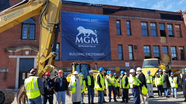 Construction workers gathered in front of the former Zanetti school building before the ceremonial groundbreaking for the MGM Springfield casino in March 2015.