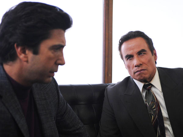Simpson's defense team members Robert Kardashian (David Schwimmer) and Robert Shapiro (John Travolta) discuss his case.