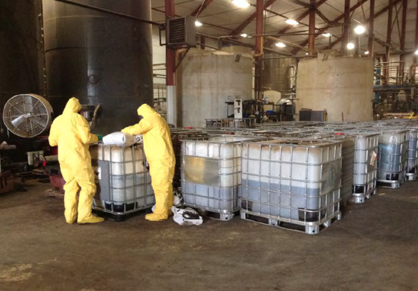 <p>This photo obtained by the Columbia Riverkeeper through a records request to the U.S. Environmental Protection Agency shows workers inside the TransMessis Columbia Plateau biofuels plant in Odessa, Washington. After being abandoned in 2014, the plant required more than $400,000 worth of environmental cleanup.</p>