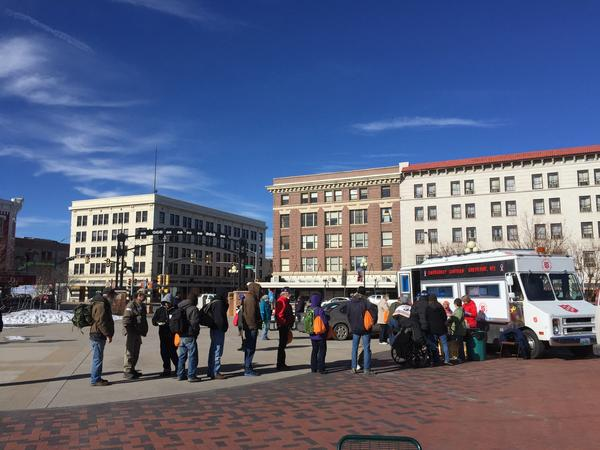 The homeless line up for lunch and hot drinks at Cheyenne's Depot Plaza in Wyoming.
