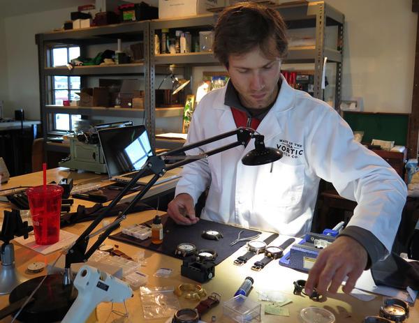 Jimmy Luper, an employee of Vortic, works on a watch. (Curt Nickisch/WBUR)
