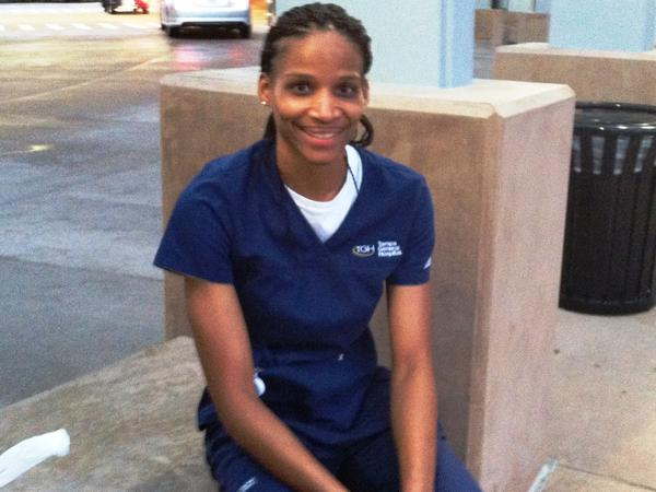 Air Force Reserves medic and registered nurse, Willamina Folks, 30, sits outside Tampa General Hospital after completing a 12-hour shift. She was in the first V-CARE graduating class at the USF College of Nursing.