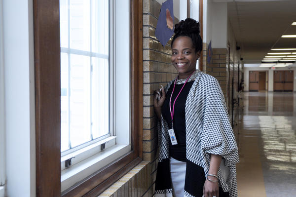 Tanjila Bolden-Myers, 38, stands in the hallway of Beaumont High School in St. Louis. She works as a behavioral health specialist and was diagnosed with sickle cell disease as an infant.