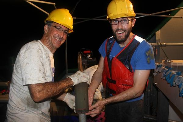 Researhcers with a soil sample removed from the ocean's core