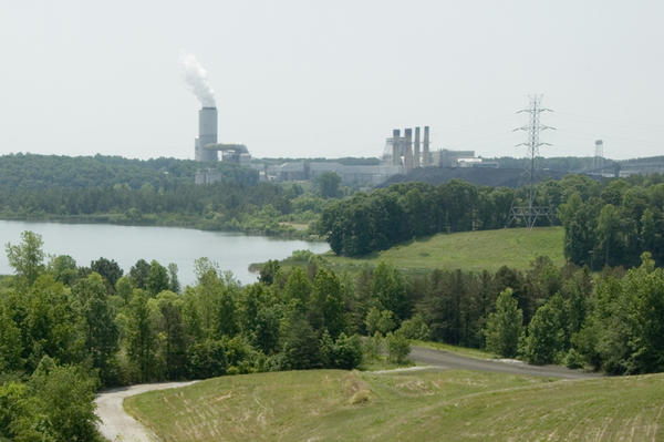 The coal ash basin at Marshall Steam Station is overgrown with trees and grass.