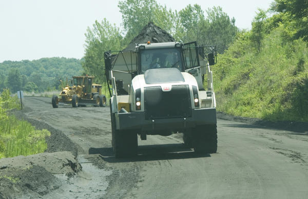 A truck hauls coal ash from the Marshall Steam Station to a landfill elsewhere on the site.