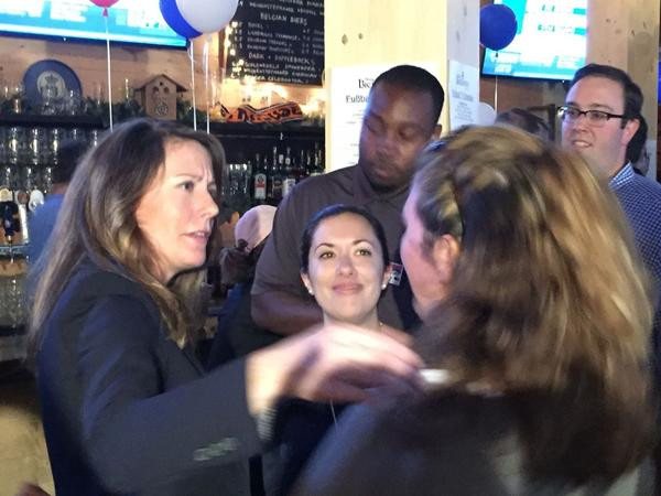 Colleen Deacon, far left, greets supporters at primary night victory party.