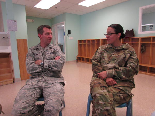 Lt. Colonel Eric Flake of Madigan Army Medical Center meets with Major Ruth Racine, whose 7 year old son is being treated for autism.