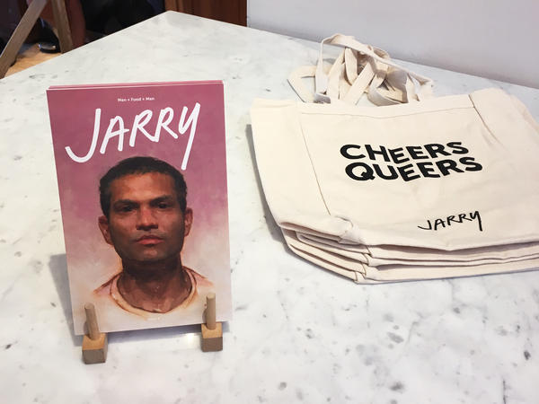 "A copy of <em>Jarry</em>, a gay men's food magazine, next to tote bags that read ""Cheers Queers."""