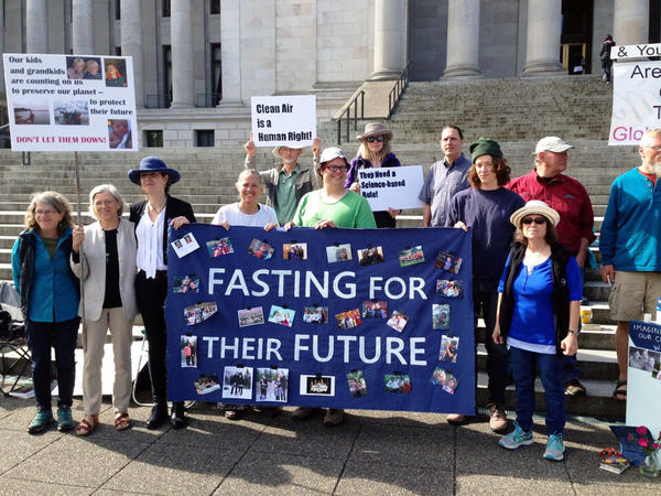 A group that is fasting as part of a protest against Gov. Jay Inslee's Clean Air Rule to cap carbon emissions says the proposed rule doesn't go far enough.