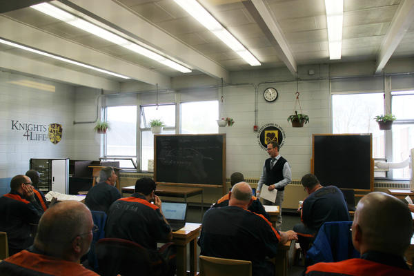 Professor Kevin Corconan teaches philosophy to student inmates.