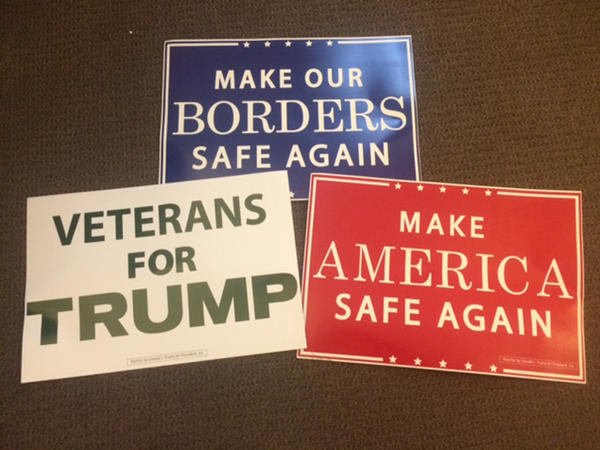 Signs from the convention floor used by delegates Monday night.