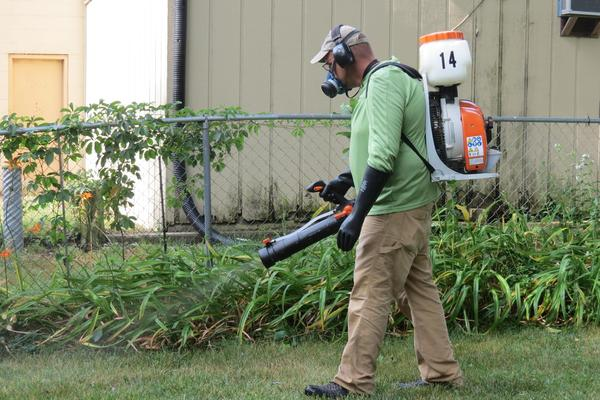 The Southwest Michigan Mosquito Squad sprays a home in Kalamazoo.