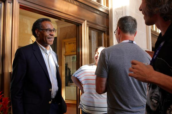 U.S. Rep. Emanuel Cleaver greets two Bernie Sanders supporters in Philadelphia. Cleaver backed Hillary Clinton during the presidential primaries.