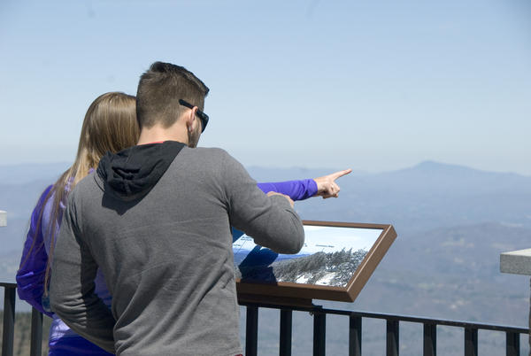 Visitors take in the view from the top of Mount Mitchell in spring.
